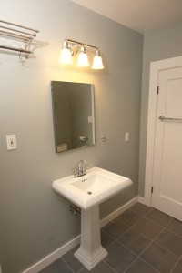 New Pedestal Sink on Tile Floor