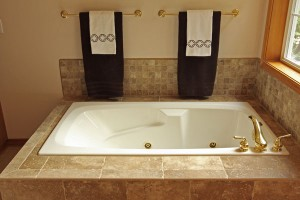 Tub with porcelain tile and brass faucet
