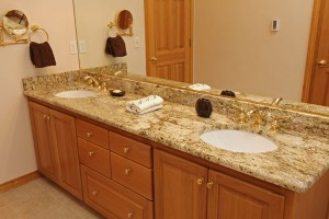 Vanity with Granite countertops and brass faucets