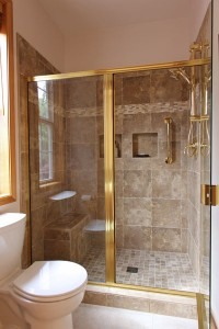 Master Bathroom shower - Porcelain tile with brass finishes